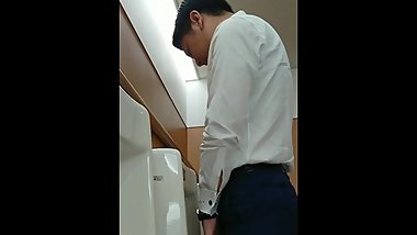 Handsome japanese guy pissing